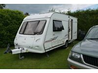 Touring Caravan Elddis Odyssey 482 2 berth 2006 with Motor Mover and Kampa Arc full awning