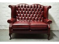Antique red leather Chesterfield wing back 2 seater sofa (DELIVERY AVAILABLE)
