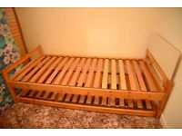 Single Pine Trundle Bed (extra bed underneath pops up) With matresses if required.