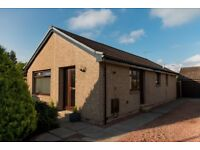 For sale 3 bedroom detached extended bungalow with conservatory
