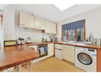 An end of terrace house split over two levels with a large open plan reception/kitchen
