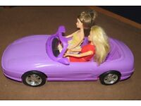 Two Barbie cars and dolls