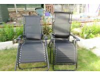 Two black folding Garden chairs