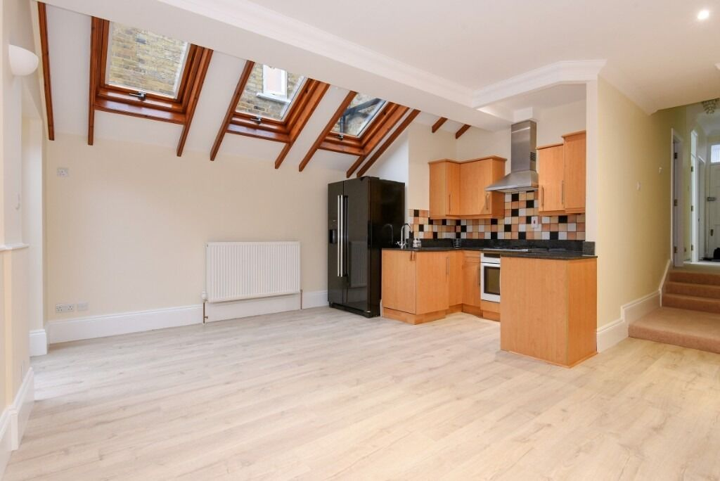 A charming recently refurbished two double bedroom garden flat, Broughton Road, SW6
