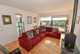 QUALITY DISTINCTIVE RED CORNER SOFA AND CUSHIONS - EXCELLENT CONDITION