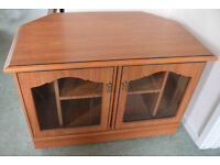 TV glass fronted corner storage unit.
