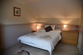 Rooms to Let in well maintained house in Wokingham within walking distance of town and station .