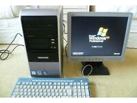 Computer Tower, Pakard Bell, Monitor, Keyboard and mouse, running windows XP Pro2.6 Ghz processor,