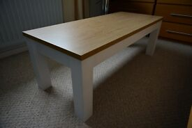 Coffee table, Pine effect table top with white satin legs.