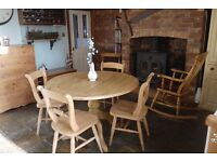 Solid pine farmhouse waxed drop-leaf table and 4 oxford scroll back chairs.