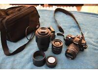 Olympus E-450 DSLR camera plus lens.