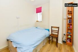 Good size single room with double bed in White City, Zone-2. All bills included. 2 Weeks Deposit