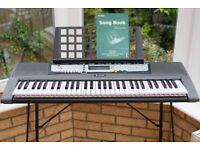 Yamaha EZ200 portable keyboard/digital piano, Yamaha stand and Behringer headphones