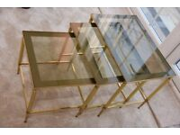 Coffee table -smoked glass top and brass legs