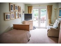 Double en-suite furnished garden bedroom/sitting room