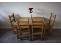 Lovely solid pine dinning room table and chairs.
