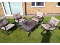 Luxury sprung garden arm chairs and table.