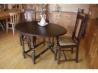 Antique barley twist dark oak gate leg drop leaf table & 2 barley twist chairs.