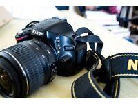 Nikon D5100 Body + Charger + 2 batteries + Nikon Strap