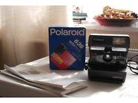 polaroid camera 636