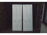 "two wooden 4 panel doors 28"" x77.5"",well made built to last,mortice and tennons no t dowels"
