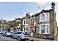 A lovely mid-terrace first floor two bedroom flat in Clapham