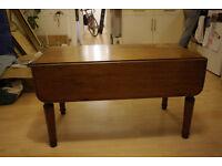 Vintage solid mohogany drop leaf side table.