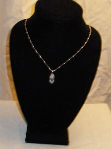 Multi real stone pendant (.925) silver chain included