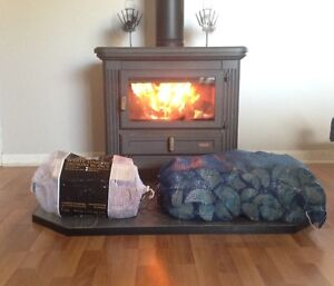 Bags of dry firewood for sale. Easy to handle and store.