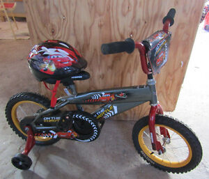 Cars toddlers bike with matching helmet in as new condition