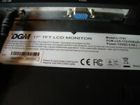 17 INCH COMPUTER MONITOR BY DGM .NO STAND. VGA CONNECTOR AND POWER SUPPLY