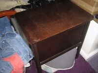 Vintage or older dark wood sewing box on legs, great project to do it up
