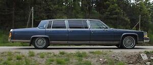A classic limo Cadillac for sale immediately.