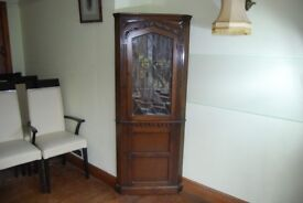 A quality oak corner display cabinet with leaded light door