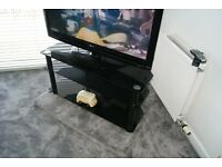 "LG 42"" HD/free view Television + smoked glass display stand"