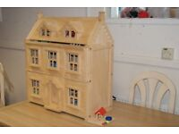 solid wood Victorian Dolls House with lots of accesories.