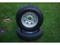 Two 12in trailer wheels (new)