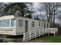 CARAVAN FOR HIRE AT HAGGERSTON CASTLE HOLIDAY PARK. (8 BERTH.)