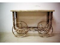 Beautiful antique hand carved solid teak wood and steel wheels console table