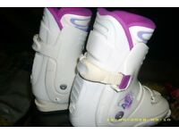 white ladies ski boots,poles and bag