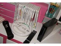 Nintendo Wii in great condition with 14 games, contoller and wheel . Also a rubber protector .