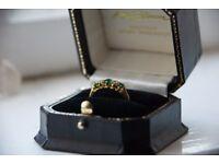 18 Carat yellow gold, diamond and emerald ladies ring.