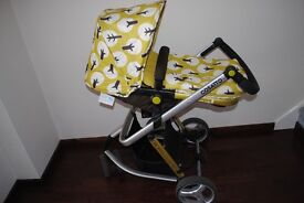 Cosatto Giggle 2 Travel System in trees