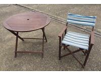 Garden table and four folding chairs