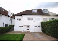 A refurbished five bed house with modern kitchen with parking close to East Finchley station