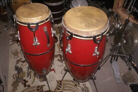 Conga drums, a nice pair with red fibreglass shells.