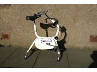 DUAL ACTION EXERCISE BIKE, WHITE, ADJUSTABLE RESISTANCE, SEAT, AND HANDLEBARS, TIMER & DISTANCE