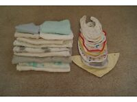 Selection of baby bibs and muslins.