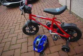 Kids Tesco bike with stabilisers and helmet.