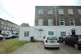 A six bedroom town house with two kitchens six bathrooms and three receptions close to transport